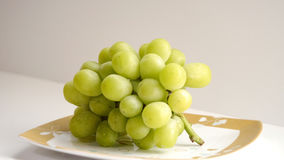 Image of Grape. There is beautiful grapes  on the plate Stock Images