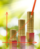 Image of graphics finance growth against coins background closeup Stock Photo