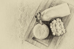 Image of greek cheese , bulgarian cheese and milk on wooden table over wooden textured background. Symbols of jewish holiday - Sha Stock Image