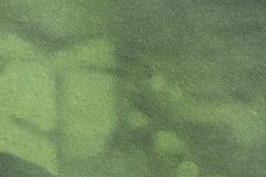 Image of green CMYK dots on newsprint. Macro image of green gradient CMYK dots on newsprint royalty free stock photo