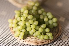 Image of Green Grapes on Wooden Stand 2019 Background royalty free stock image