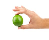 Image of green lime in hand Royalty Free Stock Images