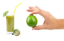 Image of green lime in hand Royalty Free Stock Photos