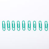 Image of green paper clips isolated Stock Images