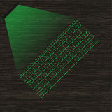 Image green virtual laser keyboard with the projection on a wooden surface. Stock Images