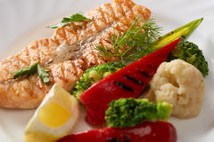 Image of grilled fish and steamed vegetables Stock Photos