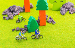 Image group of people(mini figure) with retro bicycle in a park Royalty Free Stock Photography