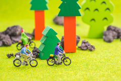 Image group of people(mini figure) with retro bicycle in a park Stock Photography