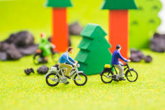 Image group of people(mini figure) with retro bicycle in a park Royalty Free Stock Image