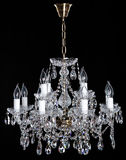 Image of grunge dark room interior with chandelier. Chrystal chandelier close-up. Luxury Glass Chandelier on white background Royalty Free Stock Image