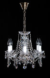 Image of grunge dark room interior with chandelier. Chrystal chandelier close-up. Luxury Glass Chandelier on white background Royalty Free Stock Photography