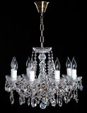 Image of grunge dark room interior with chandelier. Chrystal chandelier close-up. Luxury Glass Chandelier on white background Royalty Free Stock Photos