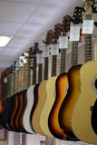 The image of guitars on a show-window Royalty Free Stock Photo