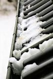 An Image of a gutter with snow royalty free stock photo