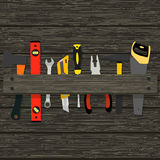 Image hammer, pliers, axes and other tools for the construction and repair of a wooden texture. Vector illustration Royalty Free Stock Photos