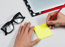 Image of hand hold pencil and sticky note Royalty Free Stock Photo