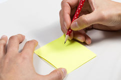 Image of hand hold pencil and sticky note Stock Photos