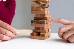 Image of hand holding blocks wood game to growing up of business. Risk of management and strategy plan stock image