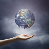 Image of hand holding earth planet Royalty Free Stock Photos