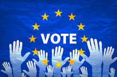 Image of hands on the background of the European flag. make a choice. vote. Cast your vote for Europe Stock Photography