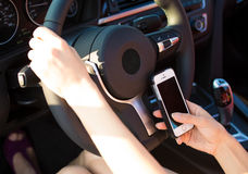 Image hands, woman sending text message on smart phone while driving to work. Closeup businesswoman, woman hands, sending text message on smart phone while stock photo