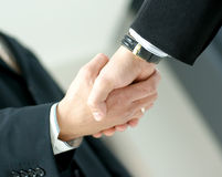 Image of a handshake between two business men Stock Image