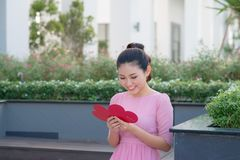 Image of happy beautiful female reading romantic postcard with big red heart, attractive woman got sensual greeting card,. Valentine day,love concept stock images