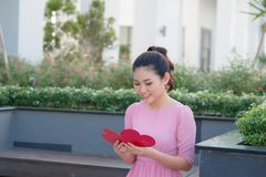 Image of happy beautiful female reading romantic postcard with big red heart, attractive woman got sensual greeting card, valentin. E day,love concept stock image