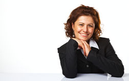 Image of a happy business woman smiling. Against white background Stock Image