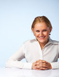 Image of a happy business woman smiling. Against light background Stock Images
