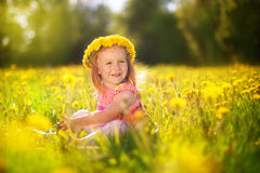 Image of happy child on dandelions field, cheerful little girl r Stock Photography