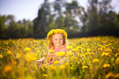 Image of happy child on dandelions field, cheerful little girl r Royalty Free Stock Photography