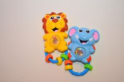 Baby toys - rattle toys. Image of happy colorful rattle toys for newborn and small baby stock image