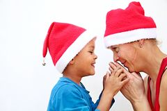 Happy mother and son looking forward to christmas and praying. Image of Happy mother and son looking forward to christmas and praying royalty free stock photography
