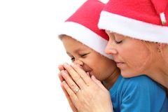 Happy mother and son looking forward to christmas and praying. Image of Happy mother and son looking forward to christmas and praying stock image