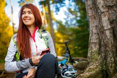 Image of happy woman with cellular phone in autumn forest Stock Photos