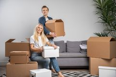 Image of happy woman and man among cardboard boxes i royalty free stock photography