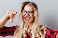 Happy young blonde woman pointing to you Stock Photo