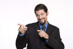 Image of a happy young businessman pointing away Royalty Free Stock Photo