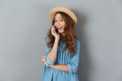 Happy young caucasian lady talking by phone. Image of happy young caucasian lady talking by phone. Looking camera Royalty Free Stock Photos