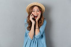 Happy young caucasian lady talking by phone. Image of happy young caucasian lady talking by phone. Looking camera Stock Photos