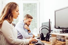 Colleagues working on desktop computer royalty free stock photography