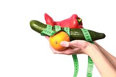 Healthy fruits and vegetables with tape measure royalty free stock photo
