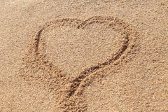 Image of a heart on the beach sand royalty free stock image