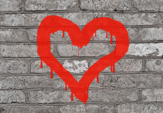 The image of heart  paint on a brick wall Royalty Free Stock Photography