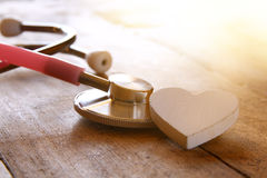 Image of heart and stethoscope. Medical concept Stock Photos