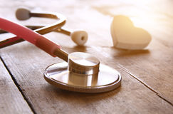 Image of heart and stethoscope. Medical concept. Image of heart and stethoscope on wooden background. Medical concept stock photography