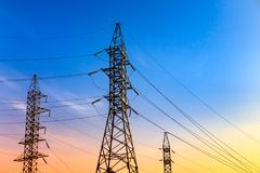 Image of high voltage power line and sky. High voltage electricity pylons and transmission power lines on the blue sky background Royalty Free Stock Photo