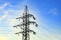 Image of high voltage power line and sky. High voltage electricity pylon against cloud on the blue sky background Royalty Free Stock Photo
