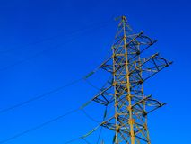 Image of high voltage power line and sky. High voltage electricity pylon against cloud on the blue sky background Stock Images